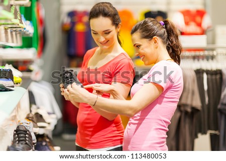 young women shopping for sports shoes - stock photo