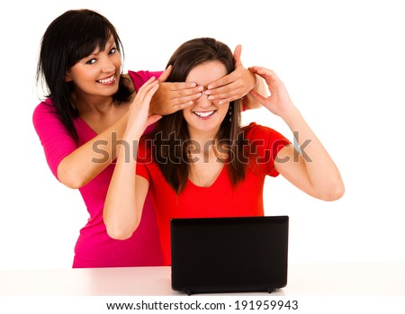 young women studying with the laptop, white background - stock photo