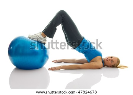 Young women training on a fitness ball. Reverse leg roll excercise; Isolated on white - stock photo