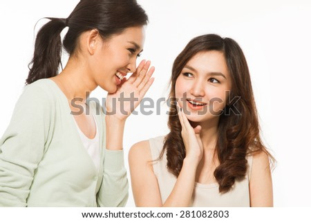 Young women whispering - stock photo