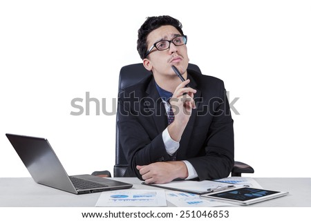 Young worker concentrate to make a solution while working with laptop on desk, isolated on white background - stock photo
