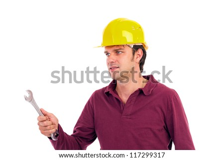 Young worker holding his wrench isolated on white background - stock photo