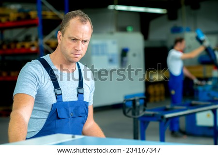 young worker in factory - stock photo