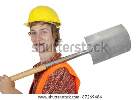 Young worker with spadeisolated on white background - stock photo