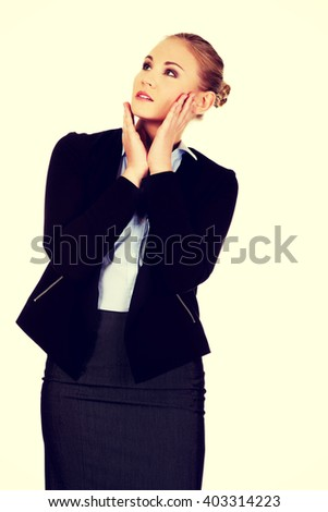 Young worried business woman looking up - stock photo