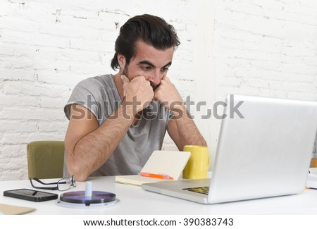 young worried student or businessman at computer suffering stress looking overworked preparing exam or deadline over business project sitting at modern home office - stock photo