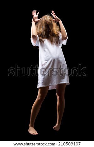 Young zombie girl isolated on black - stock photo