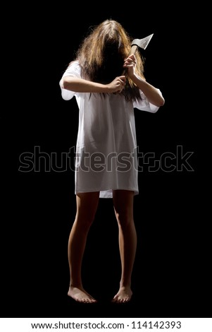Young zombie girl with axe isolated - stock photo