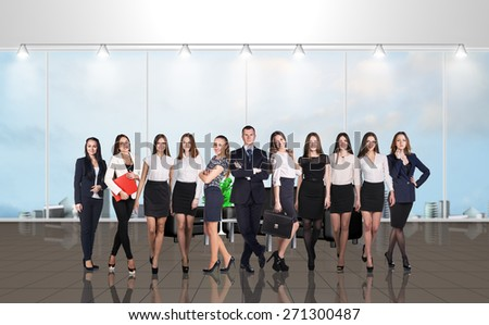 Younge team in the modern office with large windows - stock photo