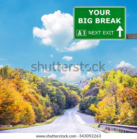 YOUR BIG BREAK road sign against clear blue sky - stock photo