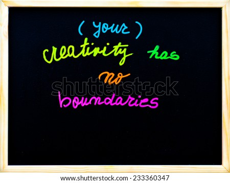 Your creativity has no boundaries message, handwriting with chalk on wooden frame blackboard, free thinking concept - stock photo
