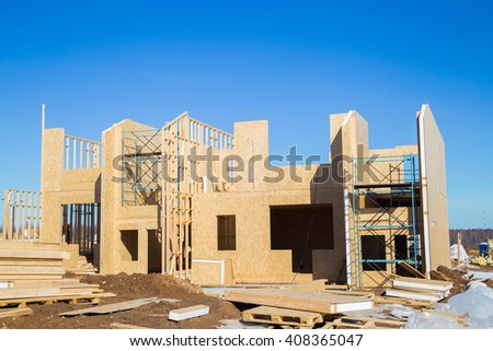 Your dream home. New residential construction house framing against a blue sky. - stock photo
