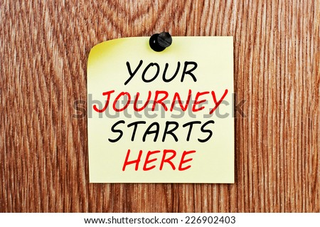 Your Journey Starts Here written on a note paper - stock photo