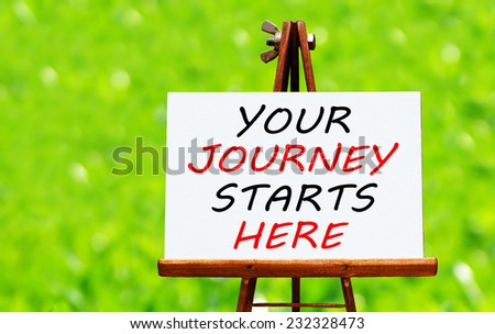 Your Journey Starts Here written on easel - stock photo