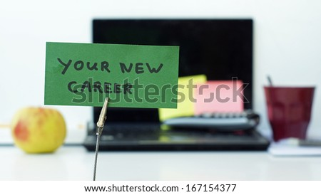 Your new career written on a memo at the office - stock photo