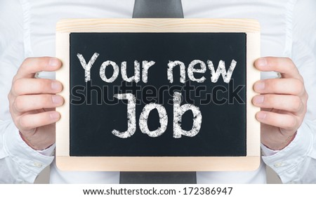 Your new Job handwritten on blackboard which holding man  - stock photo