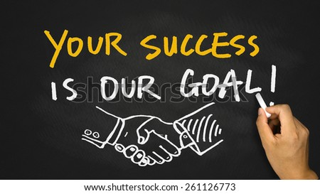 your success is our goal handwritten on blackboard - stock photo