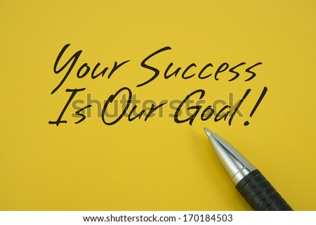 Your Success Is Our Goal note with pen on yellow background - stock photo