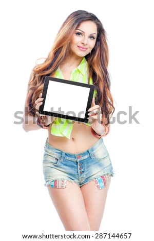 Your text here. Gorgeous young woman with long beautiful hair showing screen of tablet computer. Isolated on white. - stock photo