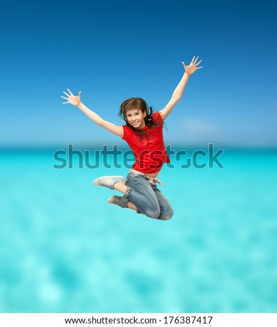 youth abd exercise concept - happy girl jumping in the air - stock photo