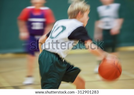 Youth basketball motion blurred image. - stock photo