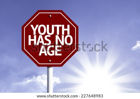 Youth Has No Age written on red road sign with a sky on background - stock photo
