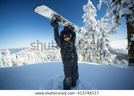 Youth snowboarder excited about the day - stock photo