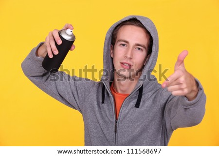 Youth with an aerosol - stock photo