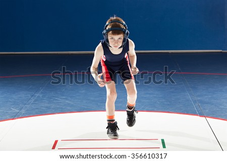 Youth wrestler in a stance - stock photo
