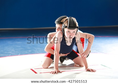 Youth wrestlers starting in the top and bottom positions - stock photo
