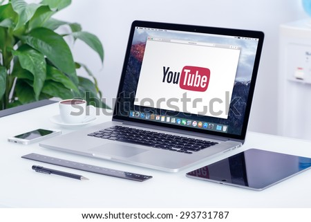 YouTube logo on the Apple MacBook Pro Retina display. YouTube presentation concept. YouTube is a video-sharing website allows users to upload, view, and share videos. Varna, Bulgaria - May 29, 2015. - stock photo