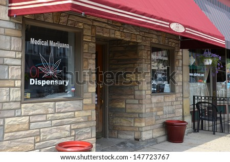 YPSILANTI, MI - JULY 3: Medical marijuana dispensaries, such as this one in Ypsilanti, MI, shown July 3, 2013, started opening after the Michigan Medical Marijuana Act was passed in 2008.  - stock photo
