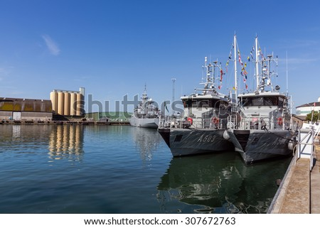 YSTAD, SWEDEN - AUGUST 6, 2015: Warships moored in the Port of Ystad during Nordic Cadet Meeting (NOCA), annual event arranged by naval warfare academies of Sweden, Norway, Denmark and Finland. - stock photo