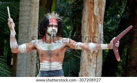 Yugambeh Aboriginal warrior throwing boomerang during cultural show in Queensland, Australia. - stock photo