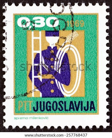 """YUGOSLAVIA - CIRCA 1969: A stamp printed in Yugoslavia from the """"New Year """" issue shows chimney sweep with ladder, circa 1969. - stock photo"""