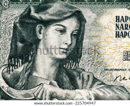 YUGOSLAVIA - CIRCA 1968: Farm woman with sickle on 5 Dinara 1968 banknote from Yugoslavia. - stock photo