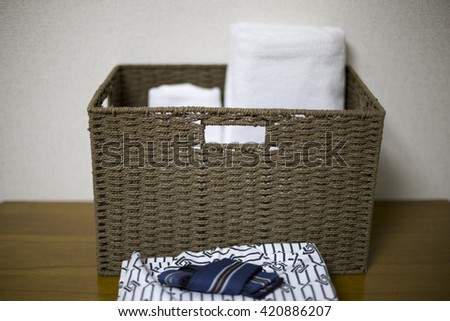 Yukata and towel in basket - stock photo