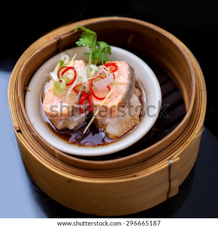 yumcha, steamed dumpling , Salmon dim sum in bamboo steamer of chinese restaurant - stock photo