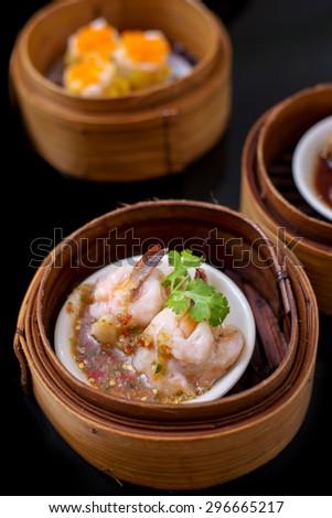 yumcha, steamed dumpling , shrimp dim sum in bamboo steamer of chinese restaurant - stock photo