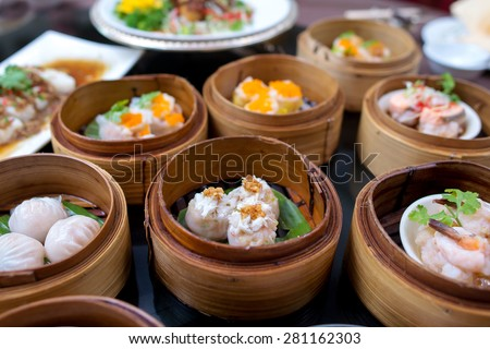 yumcha, various chinese steamed dumpling in bamboo steamer in chinese restaurant - stock photo