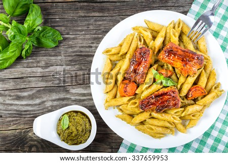 yummi pasta penne with grilled ribs, view from above - stock photo