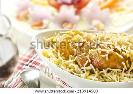 Yummy biryani with salad - stock photo