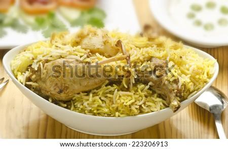 Yummy biryani with salad and rita - stock photo