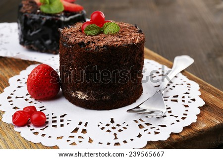 Yummy chocolate cupcake on table - stock photo
