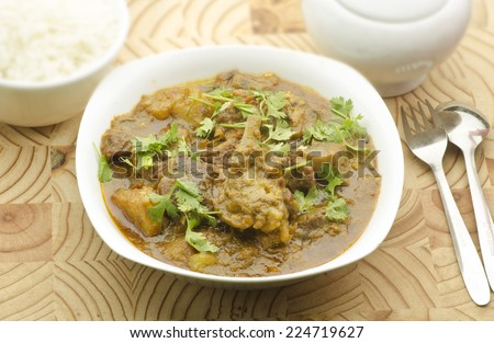Yummy delicious goat curry - stock photo
