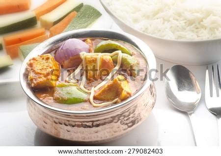 Yummy kadai paneer with salad and rice - stock photo