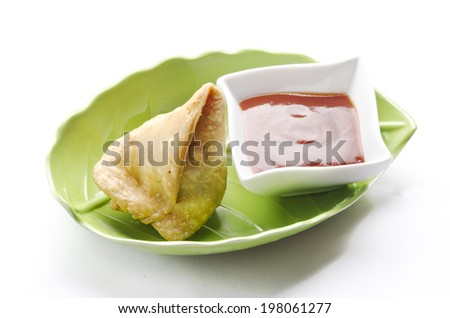 Yummy Samosas served in a nice container - stock photo