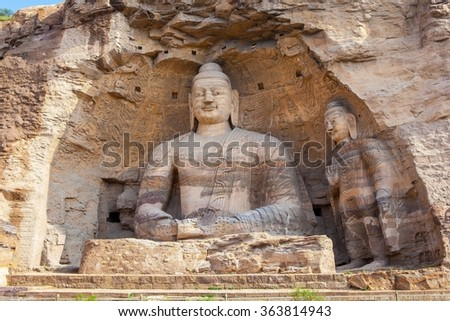 "Yungang Grottoes. World cultural heritage. One of China's four most famous ""Buddhist Caves Art Treasure Houses"", is located Datong, Shanxi Province. It is cave 20. Buddha is 13.7 metres high.  - stock photo"