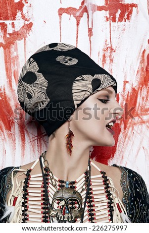 Yuong woman with Indian brestplate in studio - stock photo
