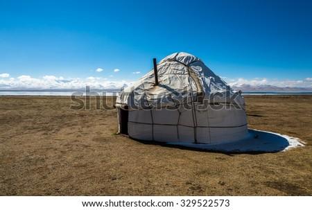 Yurt at Song Kol lake in Kyrgyzstan mountains. - stock photo